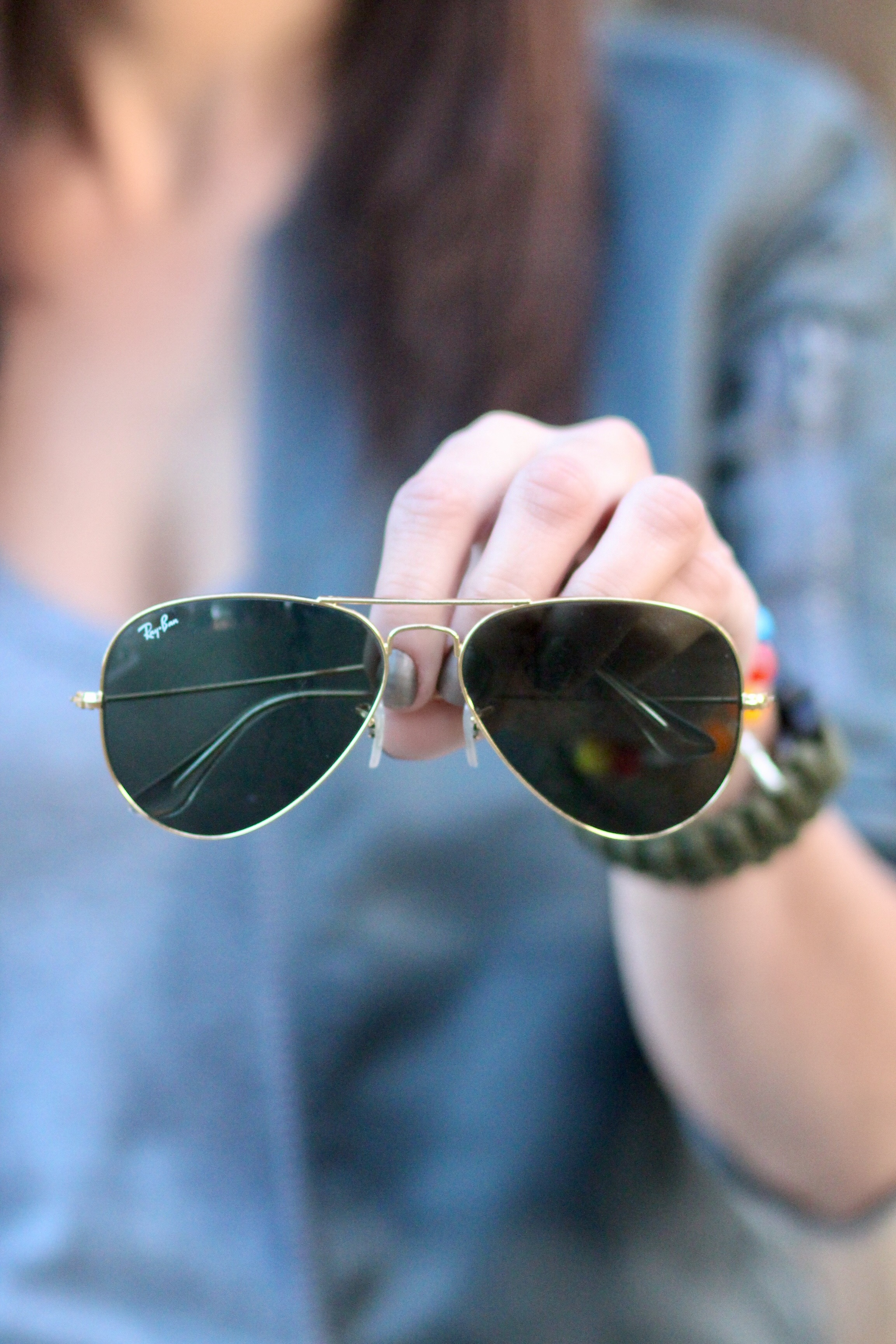 Aviator sunglasses and Essie steeling the scene nail polish