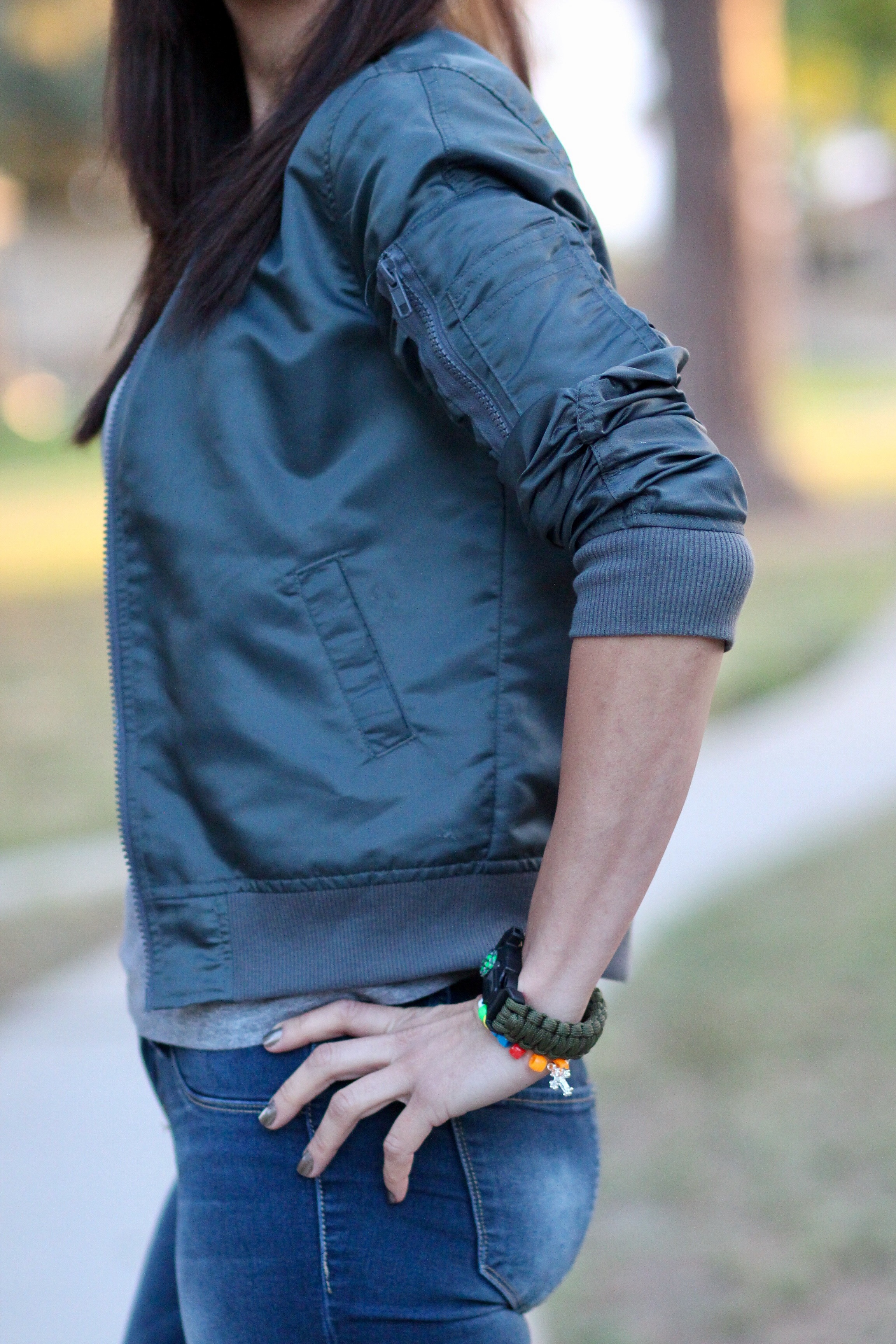 Bomber jacket with sleeve zipper detail and compass watch