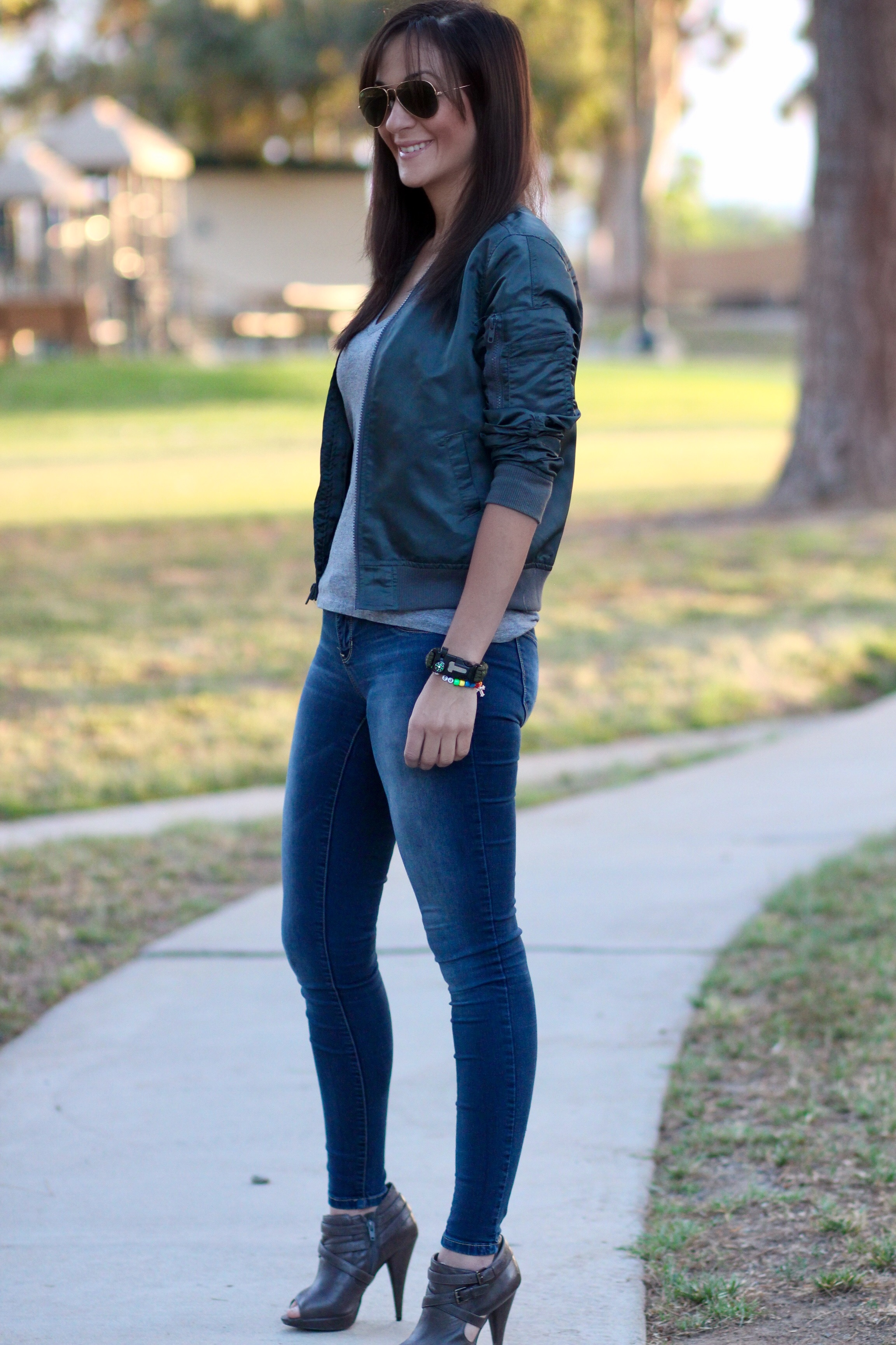 Fashion blogger Marianne Harper in bomber jacket and booties